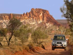 Family driving in the outback