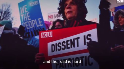 2017 03 15 snap from video by ACLU w Roger Baldwin, one of founders ACLU, dissent sign, 'the road is hard'