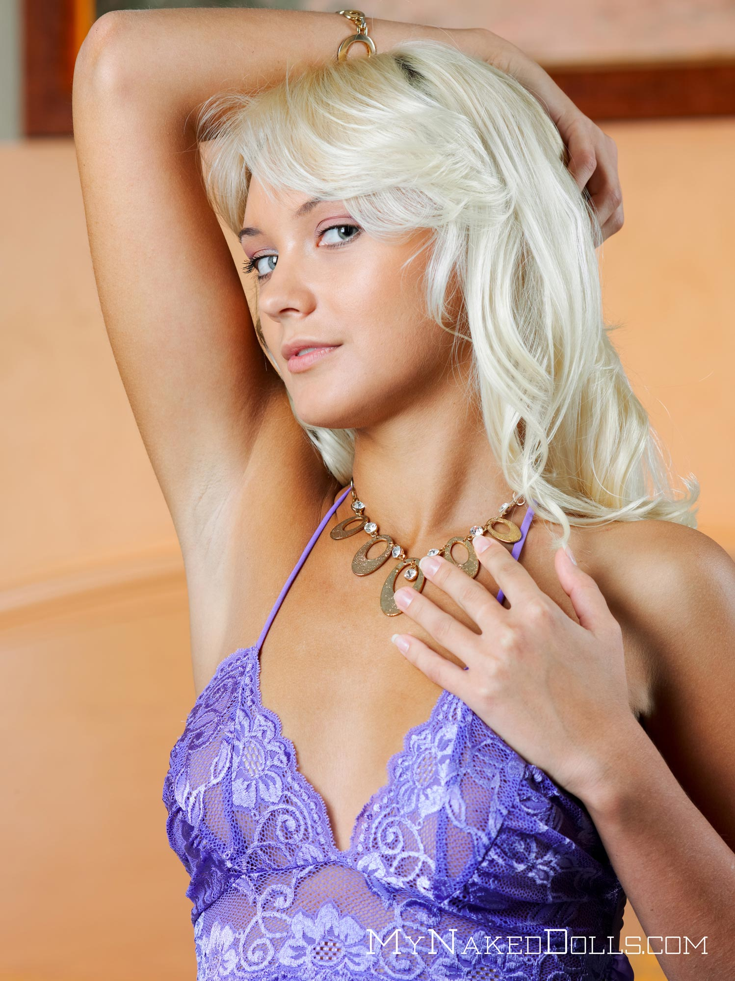 Long legged sweetie Lada D with a nice tan strips off her purple lingerie 1