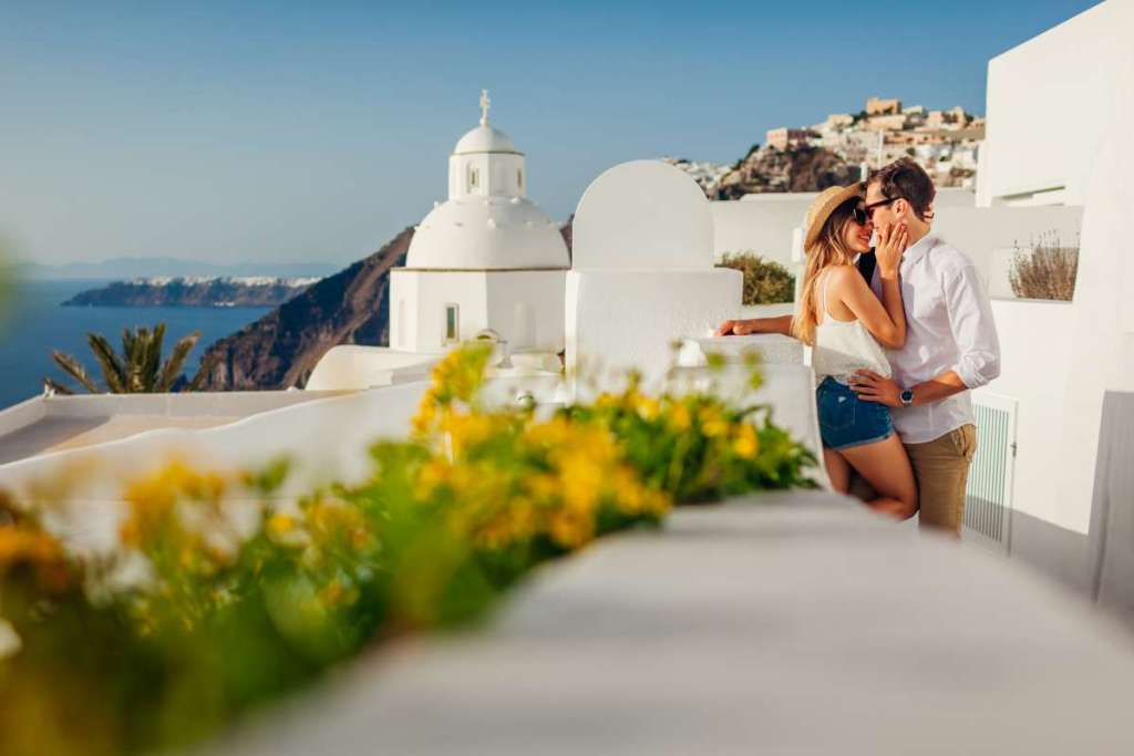 sanotrini-couple-fira-Mariia Boiko-shutterstock-plan-a-honeymoon-trip-to-Greece