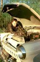 Gagarin repairing a car