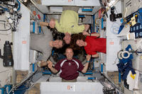 Astronauts posing in the Harmony node