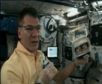 Paolo with greenhouse at the Space Station