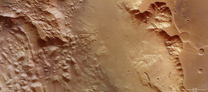 This image focuses on a section of Aurorae Chaos and Ganges Chasma on Mars.  Aurorae Chaos measures roughly 710 km across (a smaller section is shown here) and plunges some 4.8 km below the surrounding terrain.  Vast volumes of water once flooded through this deep chasm on Mars that connects the 'Grand Canyon' of the Solar System – Valles Marineris – to the planet's northern lowlands.