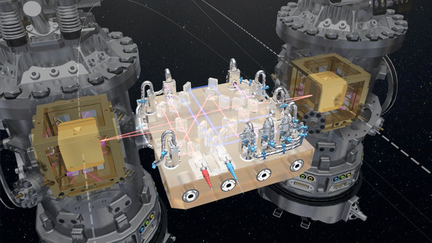 At the core of LISA Pathfinder are the two test masses: a pair of identical 46 mm gold–platinum cubes, floating freely, several millimetres from the walls of their housings. The cubes are separated by 38 cm and linked only by laser beams to measure their position continuously.