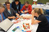 Teachers_learning_about_robotics_small.jpg