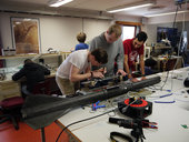 Students_preparing_the_payload_of_the_student_rocket_small.jpg