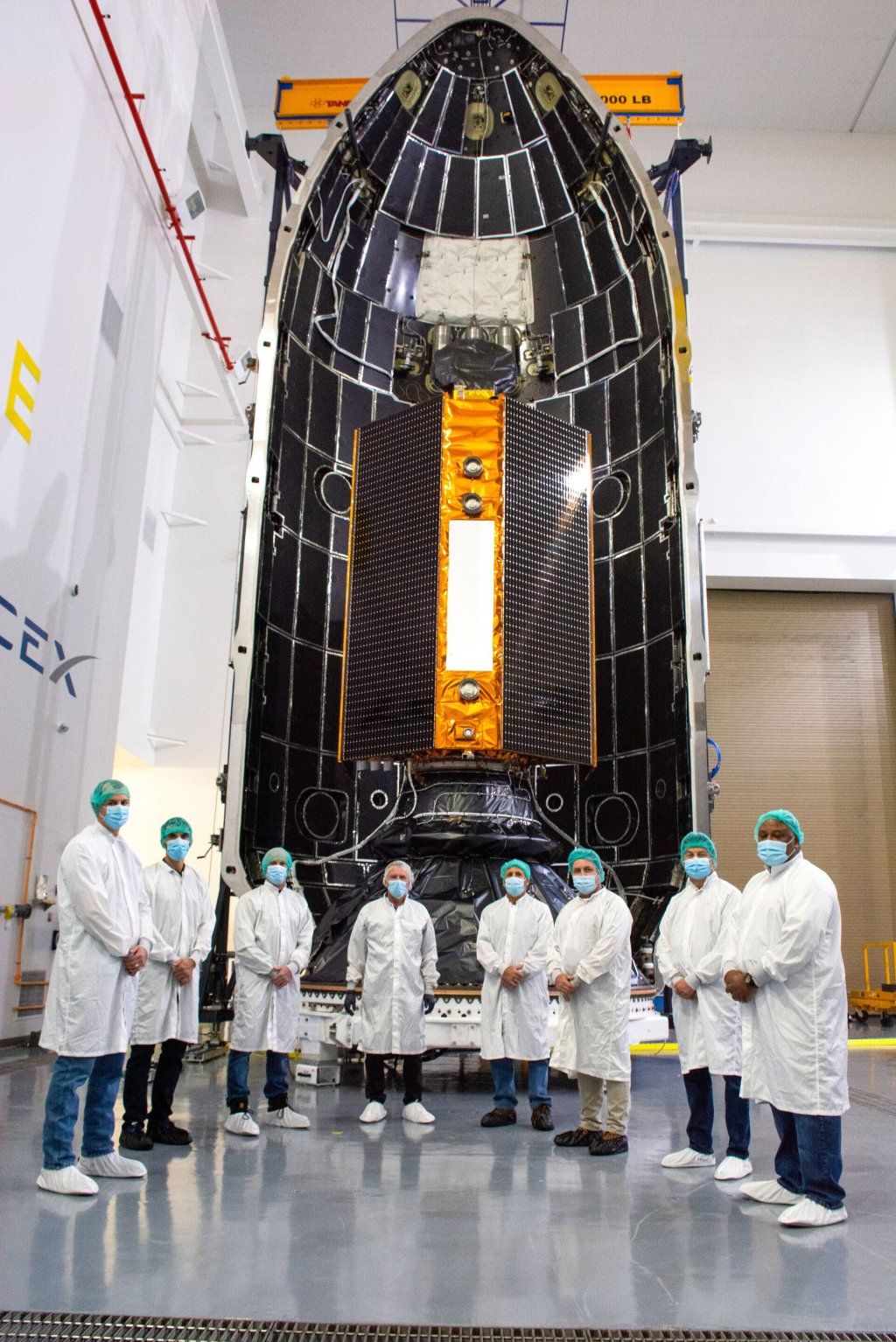 The launch campaign team in front of the satellite