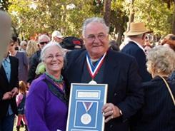 Tarzan Brizin receives his award at Ring of Fame on St Armands Circle Sarasota Florida