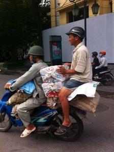 Overloaded motorcycle in Hanoi