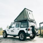 jeep camper exterior with rooftop sleeper and bike rack