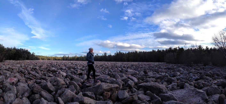 Person walking on boulders