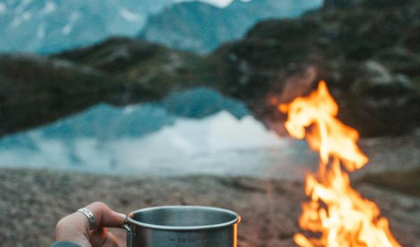 Campfire and coffee mug.