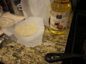 Pressing out the tortillas.  Side of canola oil to help the seasoning of that comal.