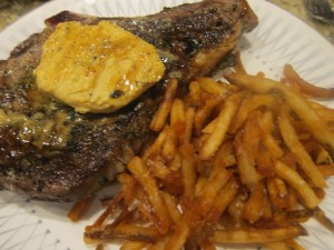 Steak with mustard butter and a side of fries aka steak frites