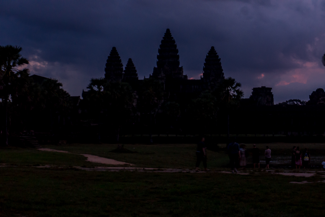 "There's only one reason to be waking up at 4am in Siem Reap. It's a seriously good reason though. No visit to Siem Reap would be complete without visiting Angkor Wat. Over 900 years ago, this huge complex was once the capital city of the Khmer Empire and it's just awesome to think that so much of it is still here today. No matter what you do, you have to spend at least 1 day at Angkor Wat. I'd previously visited Angkor Wat when I was last in Cambodia, but I can say for sure, it's no less incredible seeing it a second time around. Looking around was still a non-stop string of ""woahs"" and ""can you imagine"". Woah I can't believe this is still standing and can you imagine all this detail being carved out by hand?. No matter how many times you visit here, there's no way you could see it all. So yes, while this handful of my favourite photos may not even begin to scratch the Angkor Wat surface, I hope you enjoy them and inspire you to add a trip to your bucket list! Angkor Wat for sunrise Does this really require an introduction? I opted for an early sunrise trip (you can also do a sunset trip) and although it wasn't exactly a banger, it's still darn magical. Despite its size, finding your way to watch it in the dark was kind of tricky. It's definitely worth the early morning stumbling around though."