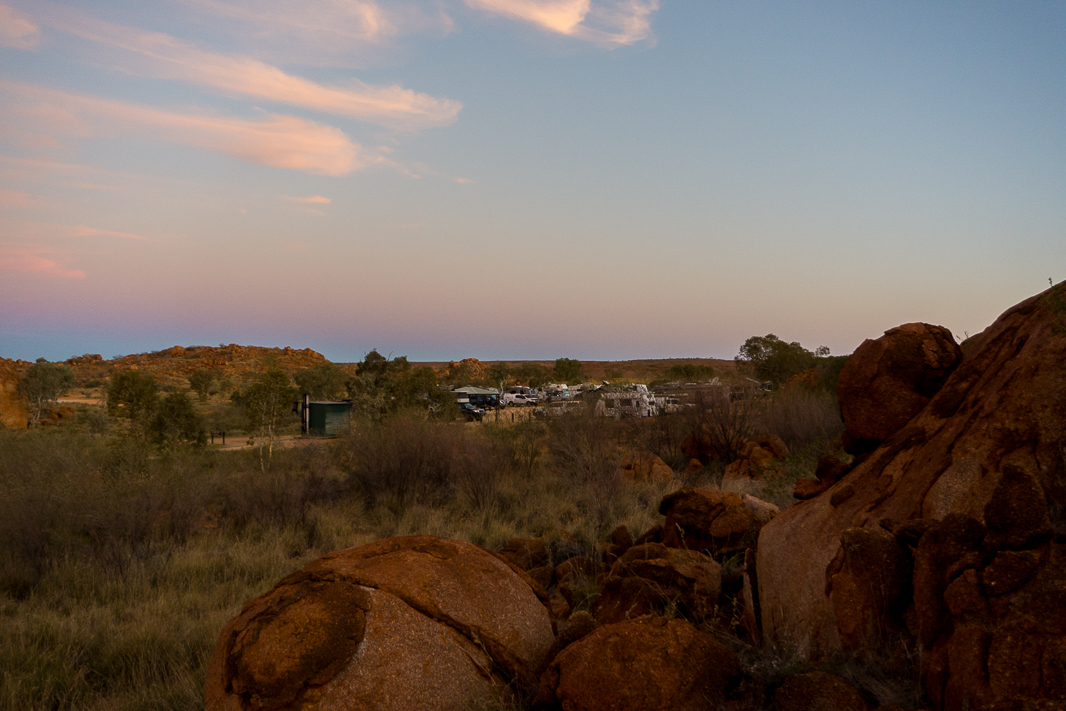 The Devils Marbles are a magnificent highlight in Australia's Red Centre! Take a look at this guide to find out how to have an incredible night here including where to stay, what to bring and what to do. #devilsmarbles #australiaredcentre #australianorthernterritory #karlukarlu #topthingstodoinaustralia #thingstoseeintheredcentre #visitaustralia #australiaroadtrip