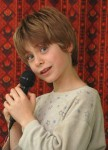 1083715_boy_singing_to_the_microphone_3