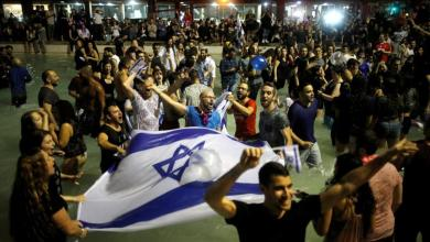 Fans celebrate in Tel Aviv after Israeli singer Netta Barzilai won the Eurovision Song Contest in 2018.
