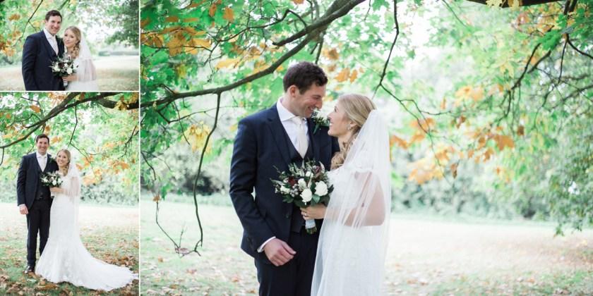 autumn wedding bride and groom portrait under tree diy rustic