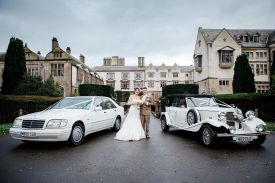 bride and groom with wedding cars outside coombe abbey vintage relaxed glamourous