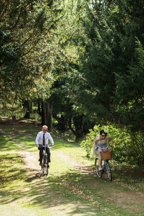 guests riding bike race wedding relaxed