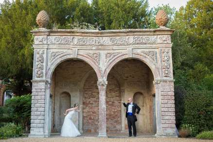 funny bride and groom portrait under the orangery ettington park stratford