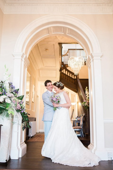 bride groom natural relaxed somerford hall wedding photography archway inside