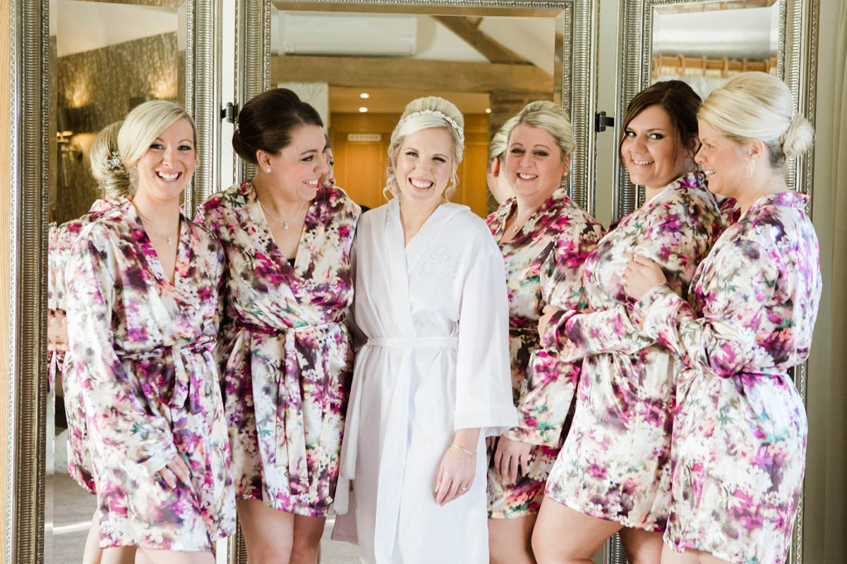 Bride and five bridesmaids in dressing gowns on wedding morning