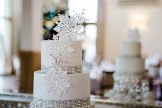 silver and white snowflake cake topper winter wedding Mythe Barn warwickshire