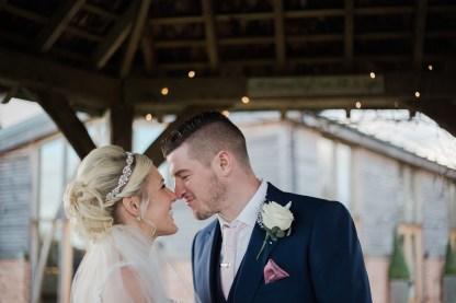 bride and groom portrait Winter Wedding Mythe Barn Warwickshire