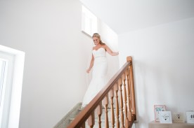 bride walks down stairs South Italian Wedding