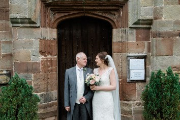 bride and dad laugh outside bradley church before ceremony