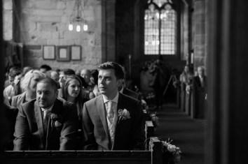 groom waits nervously before wedding ceremony at bradley church