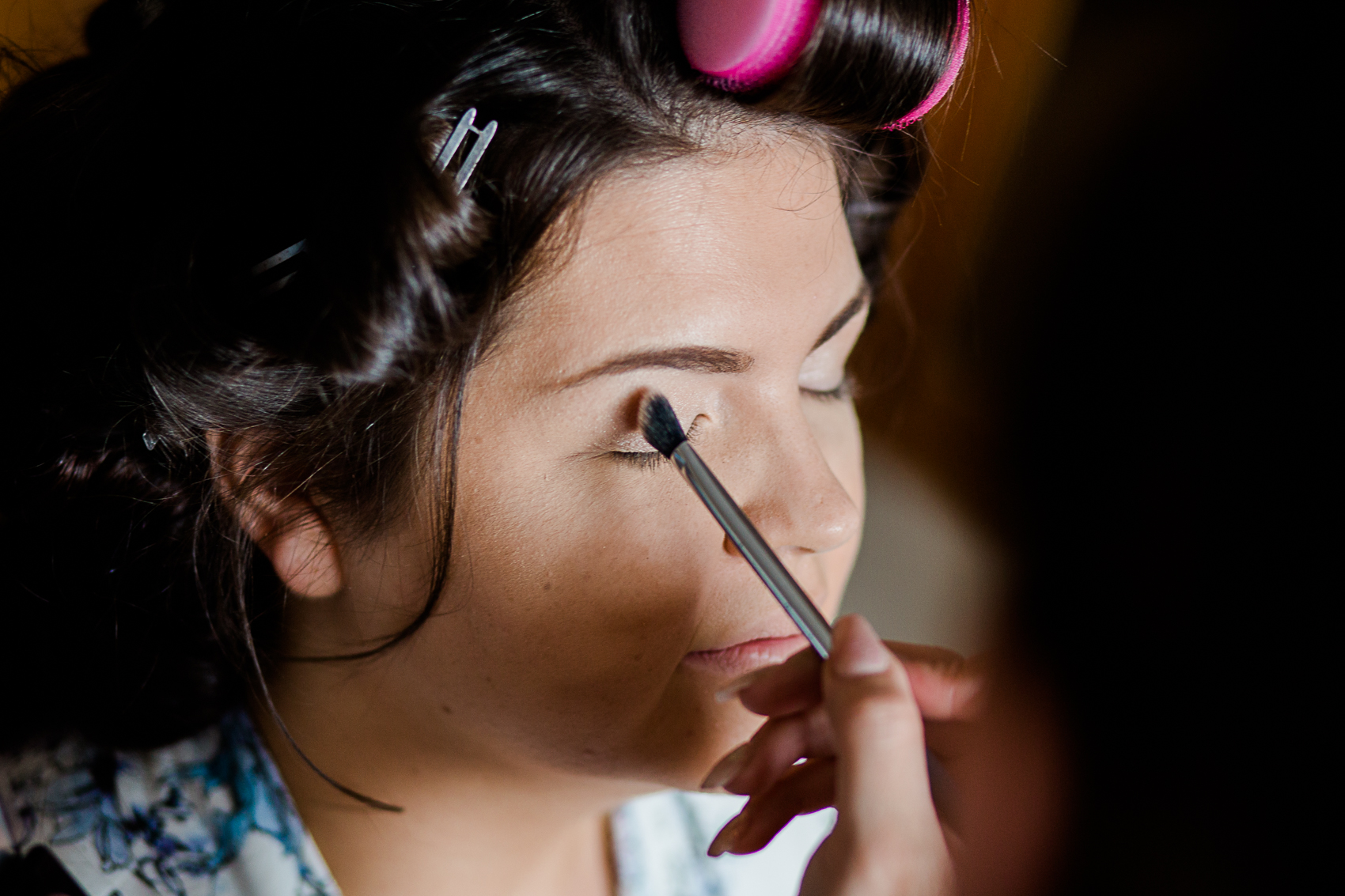 Eyeshadow being applied on bride