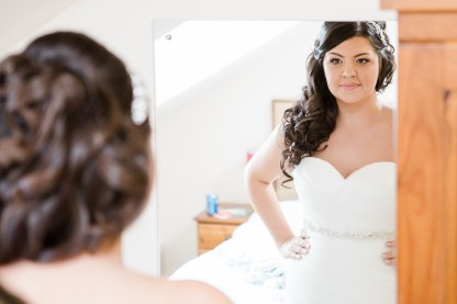 Bride Getting Dressed in Hotel Room