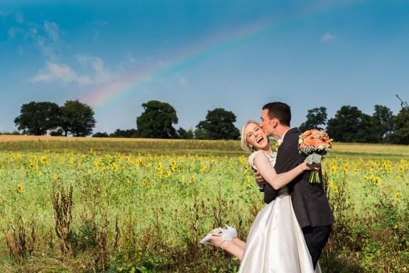 Rainbow over swallows nest barn wedding