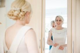 getting into wedding dress at home birmingham wedding