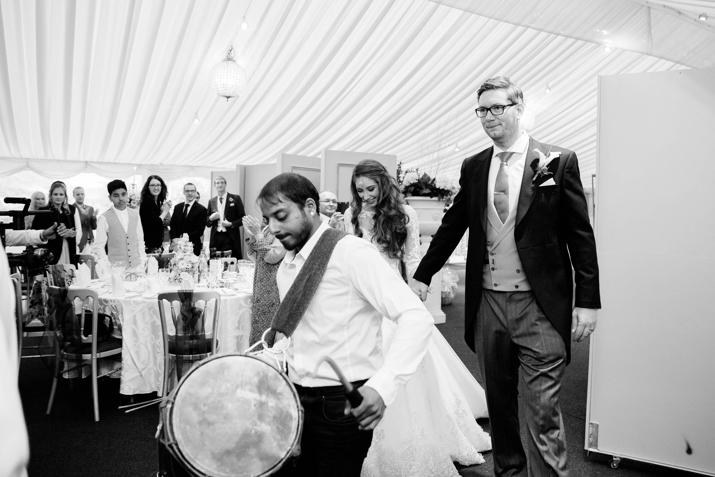 indian drummers bring bride and groom into wedding breakfast coombe abbey