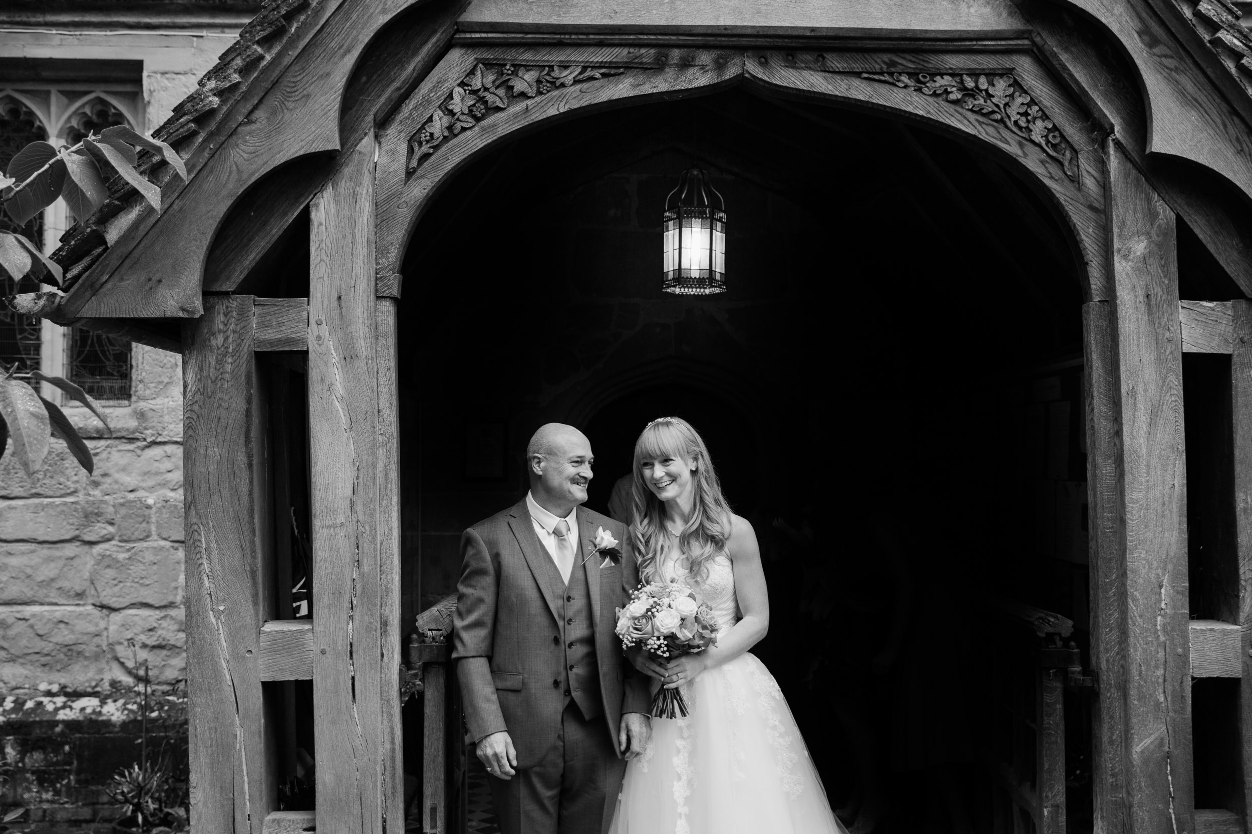 Father of bride and bride outside St Leonards Church Beoley