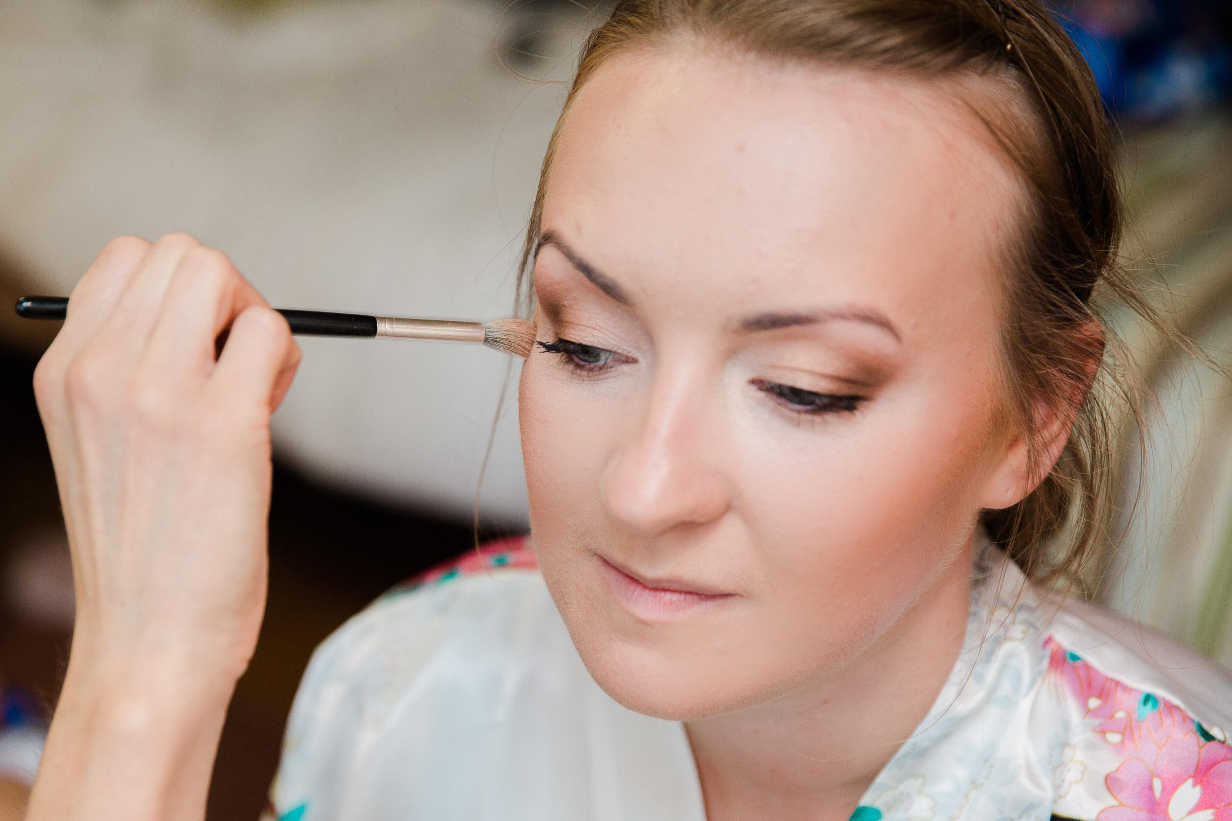 Bride having makeup applied at chesford Grange hotel