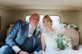 bride and father in car before wedding