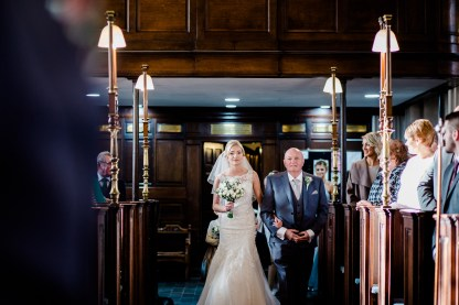 bride walks down the ailse st mary and margarets church castle bromwich