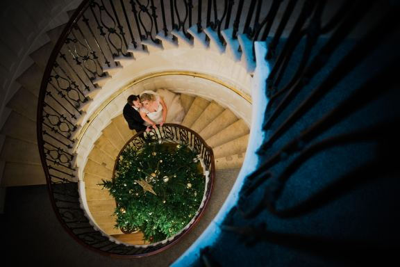 bride and groom on spiral staircase eastington park