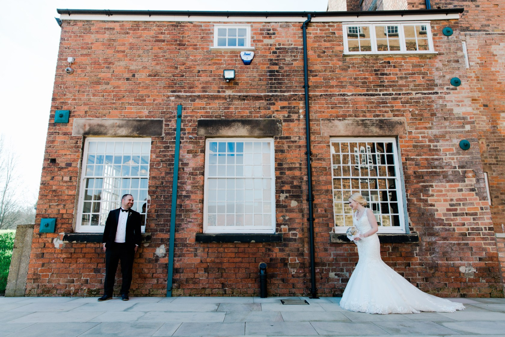 quirky photograph outside west mill symmetry industrial glamour wedding