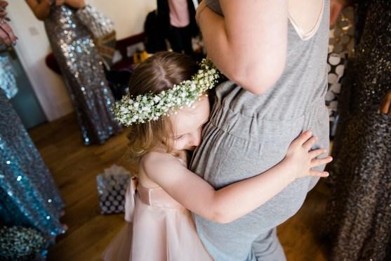 flower girl hugs mum when getting ready