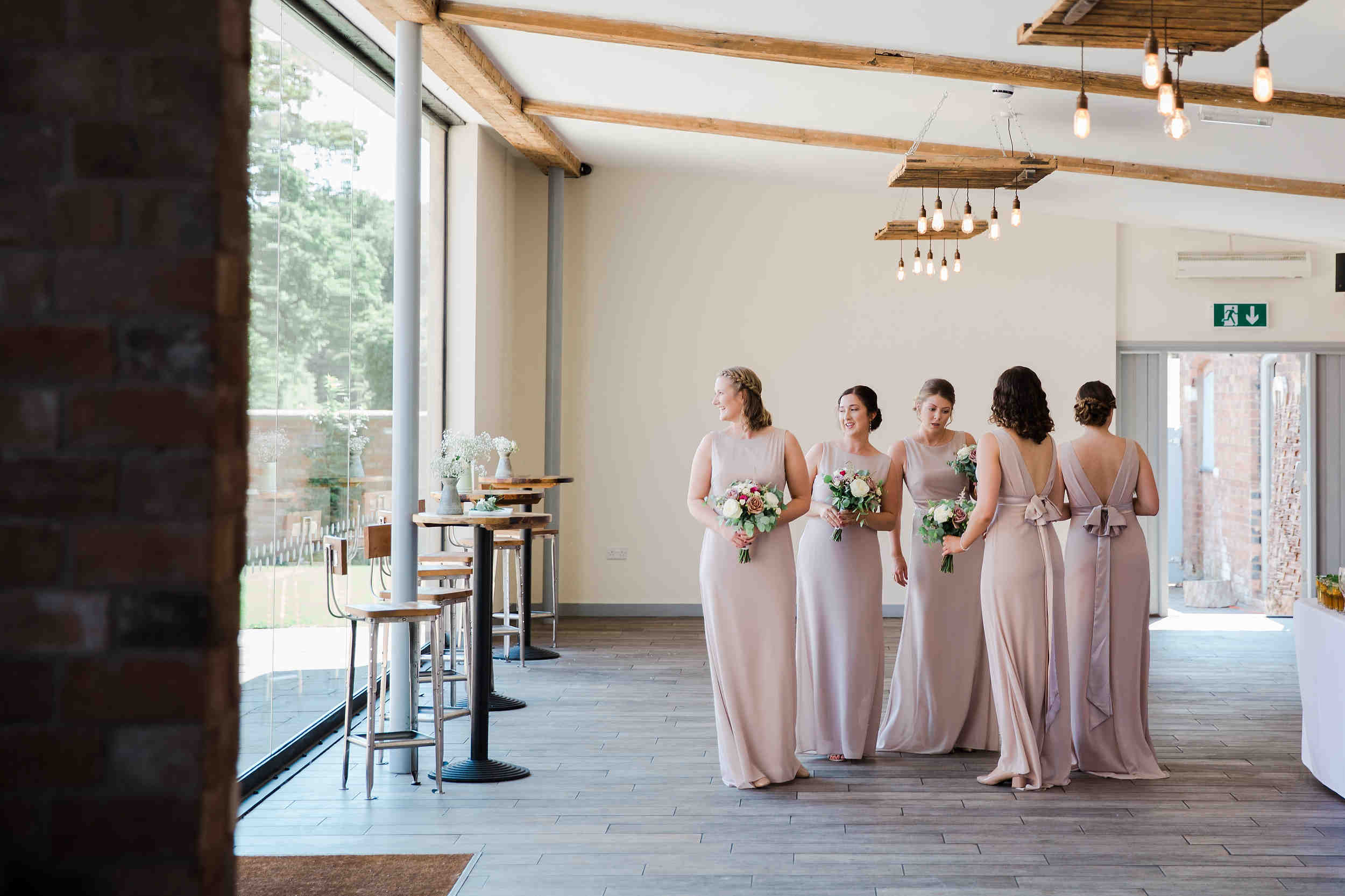 bridesmaids wait for bride in nude bridesmaid gowns