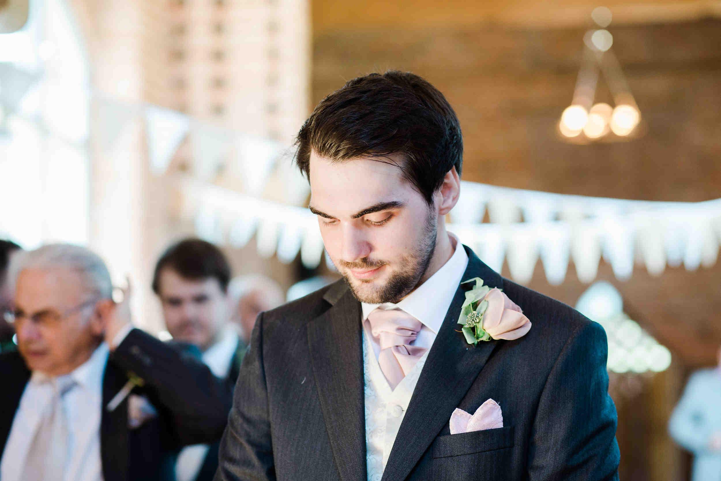 groom waits for the brides entrance swallows nest barn