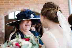 documentary style photography candid mother of the groom laughing