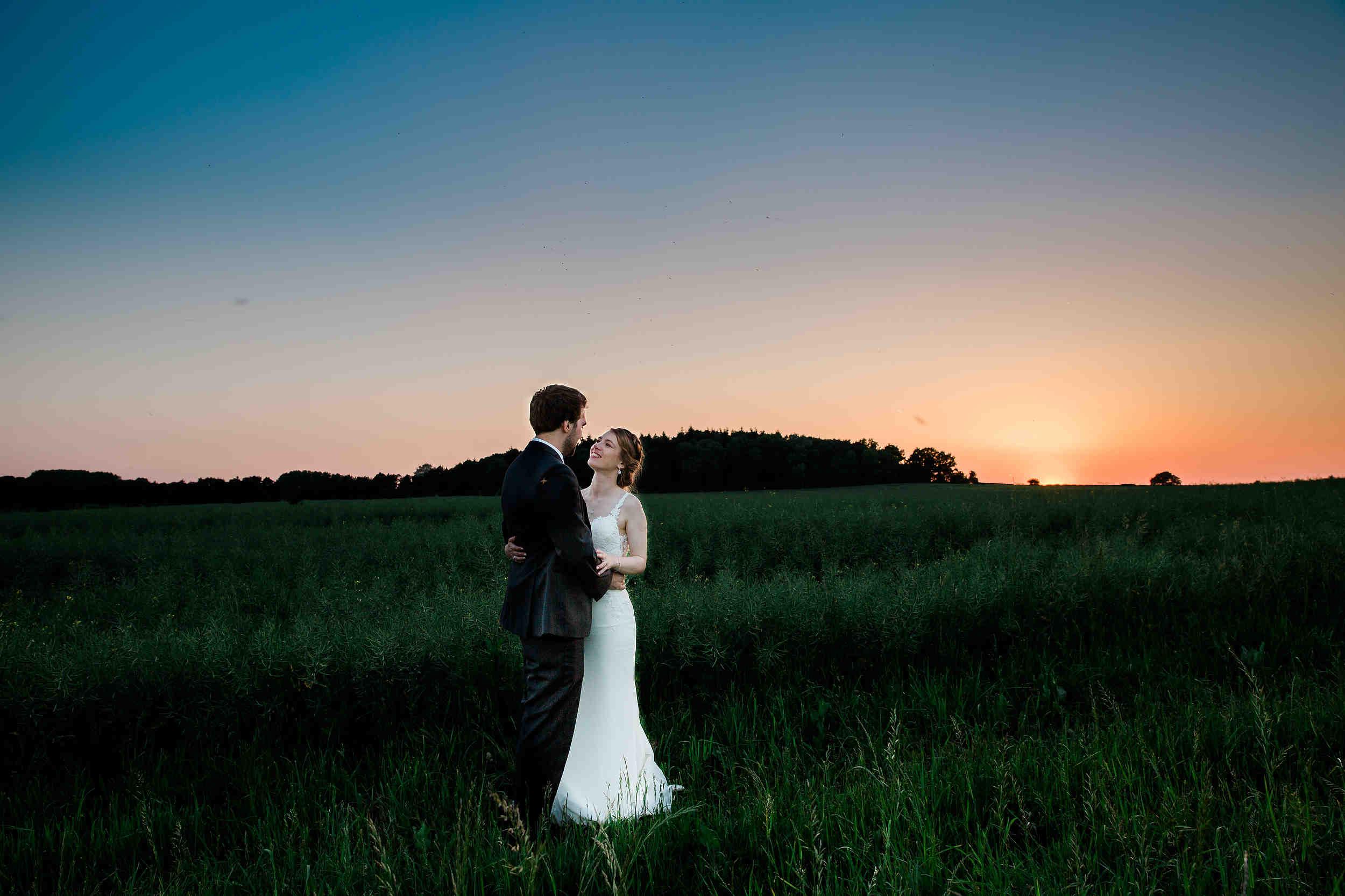 Modern Stylish Wedding at Swallows Nest Barn Sunset Portrait bride and groom